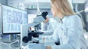 Female Research Scientist Using Electronic Microscope