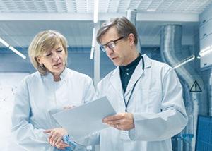 Scientists in modern laboratory
